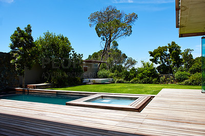 Buy stock photo A contemporary back garden with swimming pool