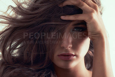 Buy stock photo Studio portrait of a gorgeous young woman posing against a grey background