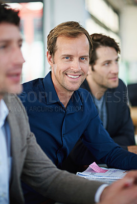 Buy stock photo Cropped shot of business people around a table