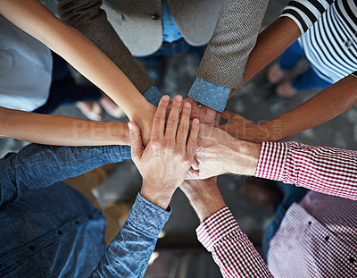 Buy stock photo Top view of co-workers hand put together in an expression of unity and team spirit