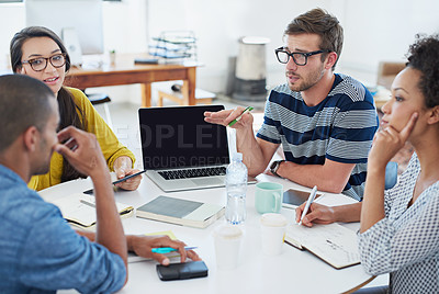 Buy stock photo Shot of a group of young designers at work in an office