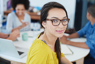 Buy stock photo Portrait of a young office worker with colleagues in the background