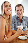 Sharing a laugh over a cup of coffee