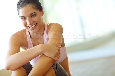 Buy stock photo A happy young woman sitting in an exercise class and smiling