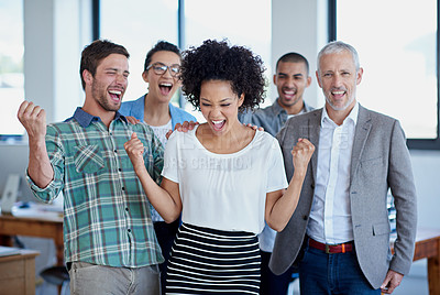 Buy stock photo Shot of a group of happy coworkers standing in an office