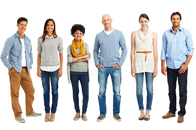 Buy stock photo Casually dressed group of young adults standing against a white background