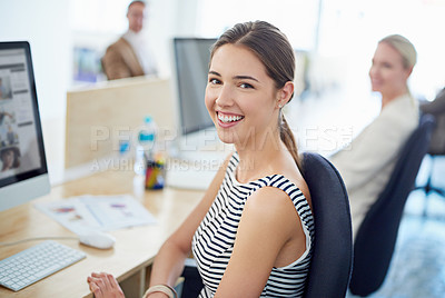 Buy stock photo Portrait of a young office worker sitting at her workstation in an office