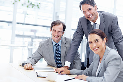 Buy stock photo Team of business executives working together with a smile - portrait