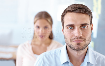 Buy stock photo Closeup portrait of two serious-looking young business professionals