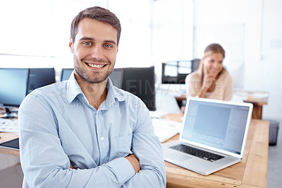 Buy stock photo Portrait of two positive-looking young business professionals at work in the office