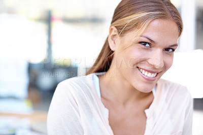 Buy stock photo Closeup portrait of an attractive young businesswoman smiling at the camera