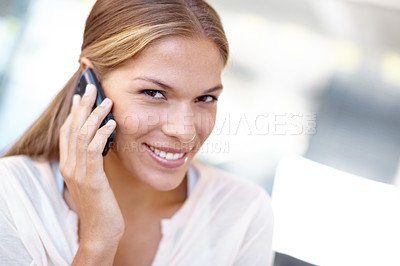 Buy stock photo Closeup portrait of a young business professional talking on her cellphone
