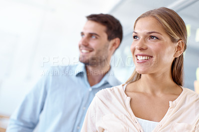 Buy stock photo Two businesspeople looking into the distance and smiling - copyspace
