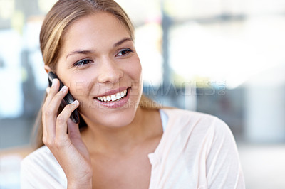 Buy stock photo Happy young businesswoman talking on a cellphone and smiling - copyspace