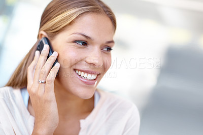 Buy stock photo Lovely young businesswoman talking on a cellphone and smiling - copyspace