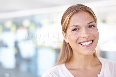 Buy stock photo Portrait of a lovely young woman smiling at the camera with a glass wall in the background - copyspace
