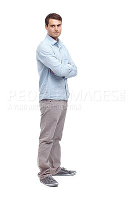Buy stock photo Handsome young caucasian man standing with his arms folded and smiling at the camera