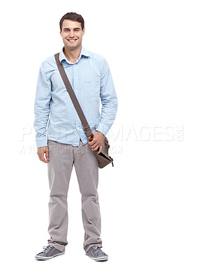 Buy stock photo Handsome young man wearing a satchel and smiling at the camera - full length