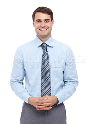 Buy stock photo Happy young businessman standing with his hands folded