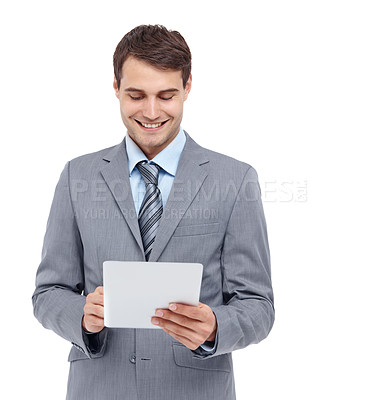Buy stock photo Handsome young businessman looking at a document - isolated