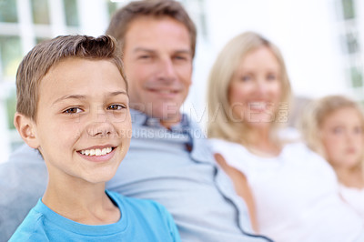 Buy stock photo A cute young boy sitting with his family outdoors