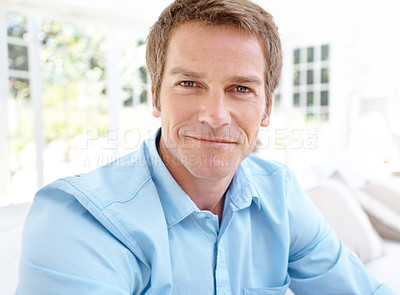 Buy stock photo Closeup portrait of a handsome mature man smiling at you in his lounge