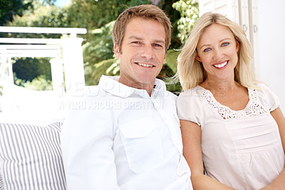 Buy stock photo A happy mature couple relaxing outdoors on a bright summer's day