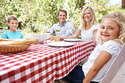 Buy stock photo A happy family sitting outside eating a meal