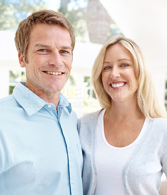 Buy stock photo Portrait of a smiling couple standing outside