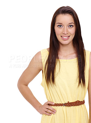 Buy stock photo Beautiful young brunette smiling against a white background with her hand on her hip