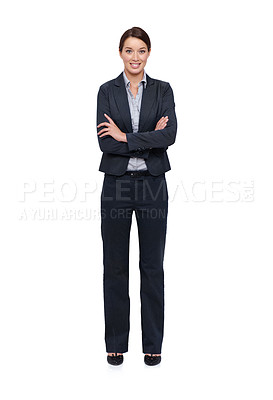 Buy stock photo Smiling young businesswoman against a white background with her arms folded