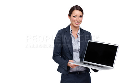Buy stock photo Young businesswoman smiling while holding a laptop against a white background