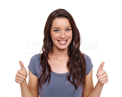 Buy stock photo Smiling young woman giving the thumb's up against a white background