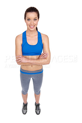Buy stock photo Full body portrait of a fit young woman crossing her arms while isolated on white