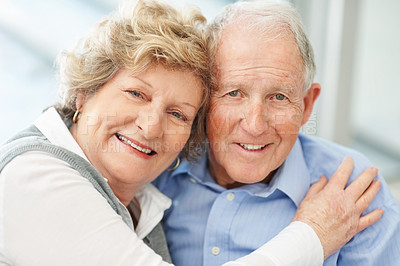 Buy stock photo Portrait of a loving senior couple giving you a smile