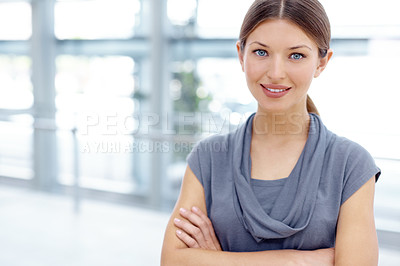 Buy stock photo A pretty young businesswoman crossing her arms alongside copyspace