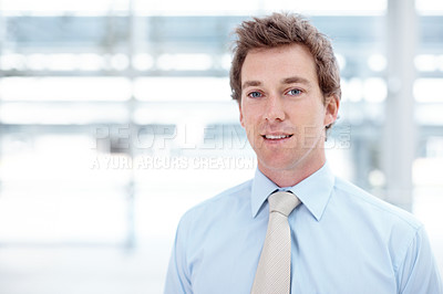 Buy stock photo Portrait of a young and ambitious businessman standing alongside copyspace