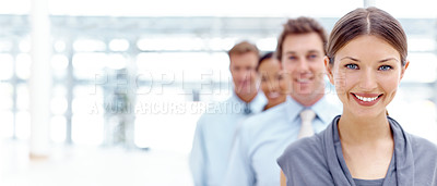 Buy stock photo A team of businesspeople standing in a line alongside copyspace