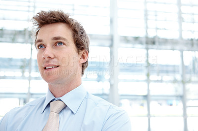 Buy stock photo Closeup of a handsome young businessman looking away