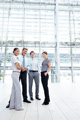 Buy stock photo Full length shot of a team of young businesspeople looking at the camera