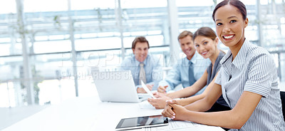 Buy stock photo A group of businesspeople smiling at the camera during a meeting