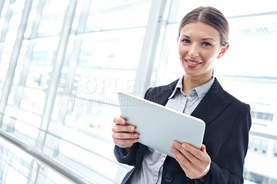 Buy stock photo A beautiful young businesswoman holding a digital tablet