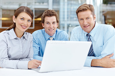 Buy stock photo A team of businesspeople working together on a laptop