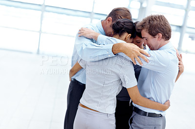 Buy stock photo Group of businesspeople standing together in a huddle of solidarity