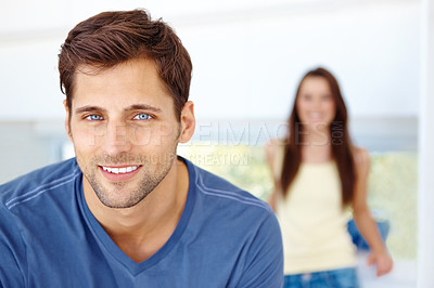 Buy stock photo Portrait of a handsome man with woman in the background