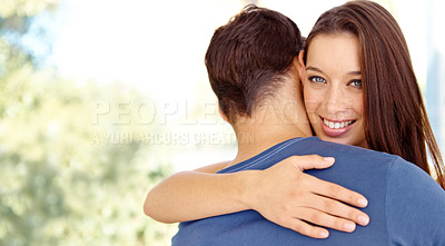 Buy stock photo Portrait of a smiling girlfriend hugging her boyfriend in the outdoors with copyspace