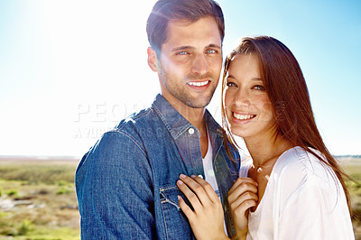 Buy stock photo Portrait of a good looking couple standing in the outdoors