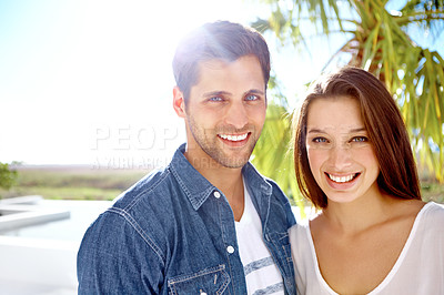 Buy stock photo Portrait of a smiling couple in the outdoors with copyspace