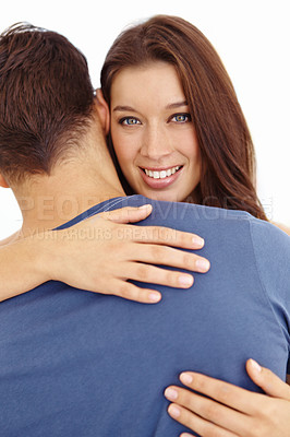Buy stock photo Portrait of a young man with his back to the camera being hugged by his attractive wife
