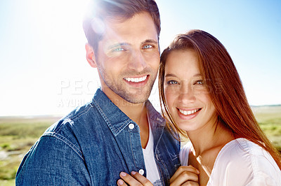 Buy stock photo Close up portrait of a happy-looking young couple enjoying a day out